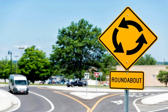 Slow down as you approach a roundabout, and watch for pedestrians and cyclists in addition to cars.