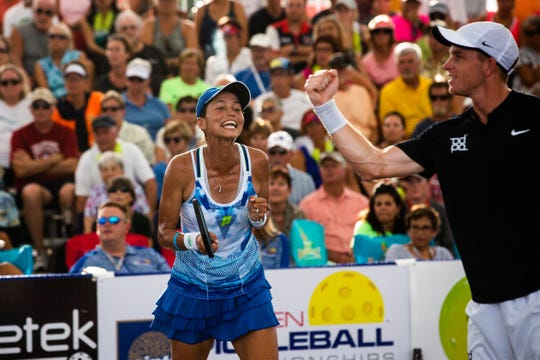 Simone Jardim and Kyle Yates celebrate at the Minto U.S. Open Pickleball Championships at East Naples Community Park on Saturday. The pair won the mixed doubles title.