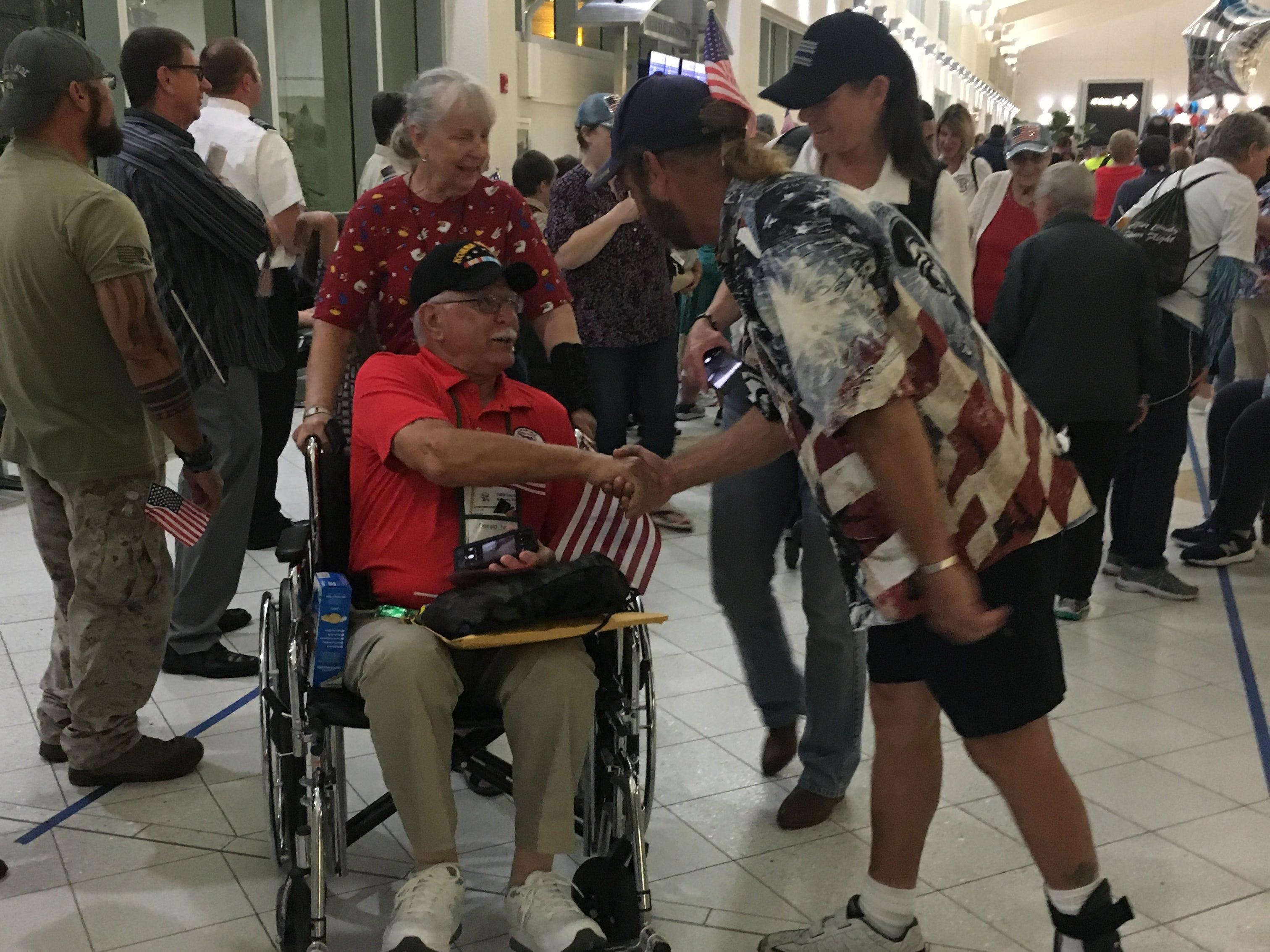 Korean War veteran Donald Turnes is greeted by fellow veterans at Southwest Florida International Airport Saturday, May 4, 2019.