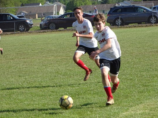 Braden Gibson takes a lead pass from Aaron Anderson for U14 XTABI on Sunday during a 4-2 victory against TSC United in the championship game of the Buckeye Cup at Alford-Reese Park.