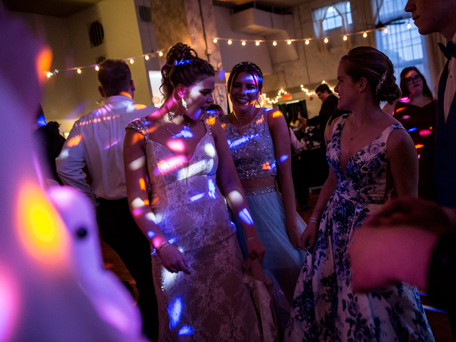 Newark High School students Courtney Brown and Hailey Sutyak enjoy their prom at the Skylight in downtown Newark Saturday evening.