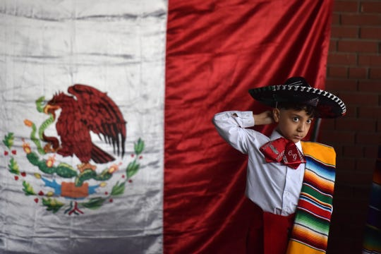 The corner on Dayton Ave. and Monroe Ave. in Passaic was named Plaza Garibaldi on Cinco de Mayo on May 5, 2019. Christian Gonzalez, 9 adjusts his hat prior to perform tradition Mexican folk dances with Baile Folklorico Raices Mexicanas.