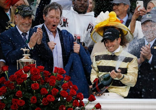 Flavien Prat celebrates after riding Country House to victory during the 145th running of the Kentucky Derby horse race at Churchill Downs Saturday, May 4, 2019, in Louisville, Ky.