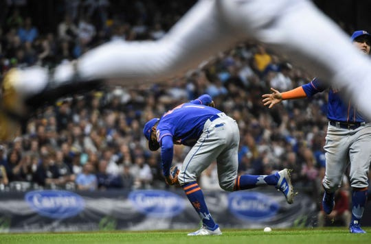 May 4, 2019; Milwaukee, WI, USA;  New York Mets shortstop Amed Rosario (1) can't make a play on an infield hit by Milwaukee Brewers left fielder Ryan Braun (not pictured) in the sixth inning at Miller Park.
