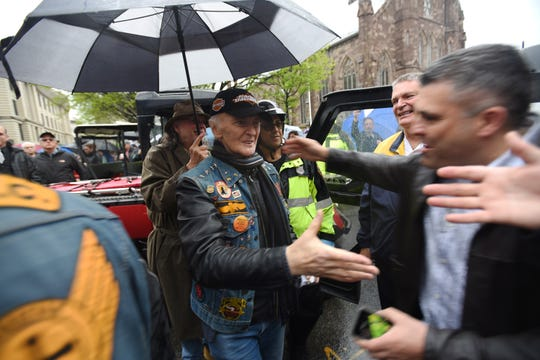Reverend Monsigner Mark Giordani is greeted as he arrives for the 50th Annual Motorcycle Mass and Blessing held by the Christian Riders Motorcycle Club outside of the Cathedral of Saint John the Baptist in Paterson on 05/05/19.