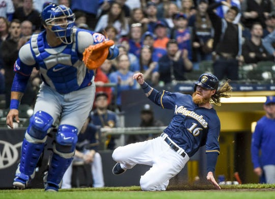 May 4, 2019; Milwaukee, WI, USA;  Milwaukee Brewers left fielder Ben Gamel (16) scores as New York Mets catcher Wilson Ramos (40) reaches for the ball in the third inning at Miller Park.
