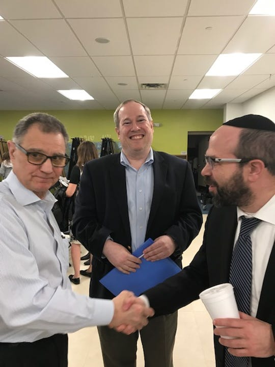Etiel Forman (Center) who launched a campaign to fight addiction in his community, pictured with Bergen County Prosecutor Dennis Calo (L) and Rabbi Lawrence Rothwachs (R)