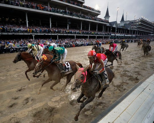 Flavien Prat ride Country House, left, to the finish line during the 145th running of the Kentucky Derby horse race at Churchill Downs Saturday, May 4, 2019, in Louisville, Ky. Country House was declared the winner after Maximum Security was disqualified following a review by race stewards.