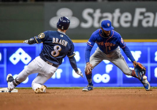 May 4, 2019; Milwaukee, WI, USA;  Milwaukee Brewers left fielder Ryan Braun (8) slides into second base with a double before the tag by New York Mets shortstop Amed Rosario (1) in the 14th inning at Miller Park.