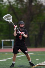 Ridgewood lacrosse plays Northern Highlands at Mahwah on Saturday May 4, 2019. NH#4 Conor Breen has the ball.
