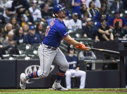 May 4, 2019; Milwaukee, WI, USA;  New York Mets first baseman Pete Alonso (20) hits a solo home run in the ninth inning against the Milwaukee Brewers at Miller Park.