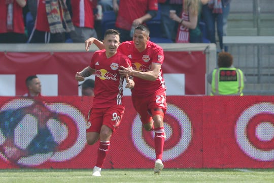 New York Red Bulls midfielder Marc Rzatkowski (90) celebrates his goal against the LA Galaxy with New York Red Bulls midfielder Sean Davis (27) during the second half at Red Bull Arena in Harrison on May 4, 2019