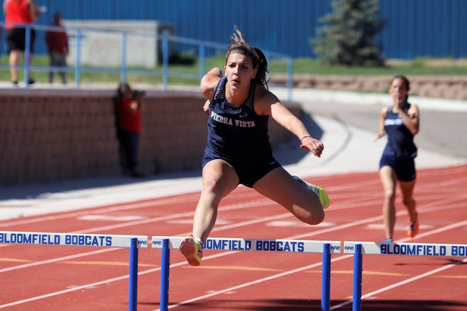 Piedra Vista's Bailey Rasmussen clears a hurdle to win the second heat of the girls 300-meter hurdles preliminary round Friday at the Bloomfield Invitational. Rasmussen's already qualified for state in the girls 100-meter hurdles, 300-meter hurdles and pole vault.