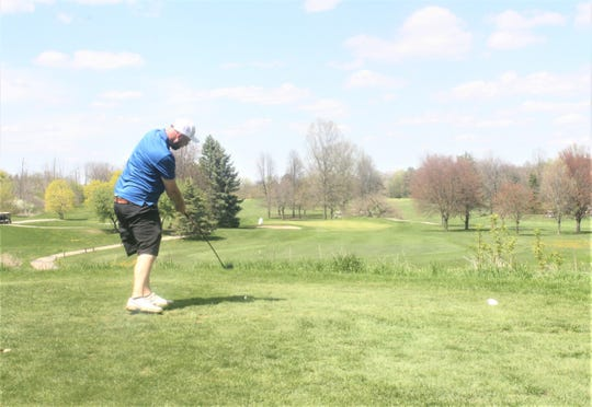 Westland's Evan Karzynow tees off on the par 3 11th hole at Hilltop Golf Course.