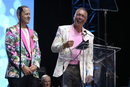 Glenn Johnson and Michael Melancon speak after receiving the Gloria Greene Inspiration Award at the 26th anniversary Evening Under the Stars gala in Palm Springs on Saturday.