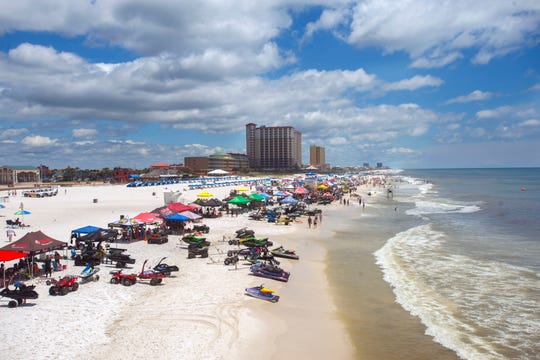 Conservation advocates want local politicians to do more to protect Pensacola Beach from development.