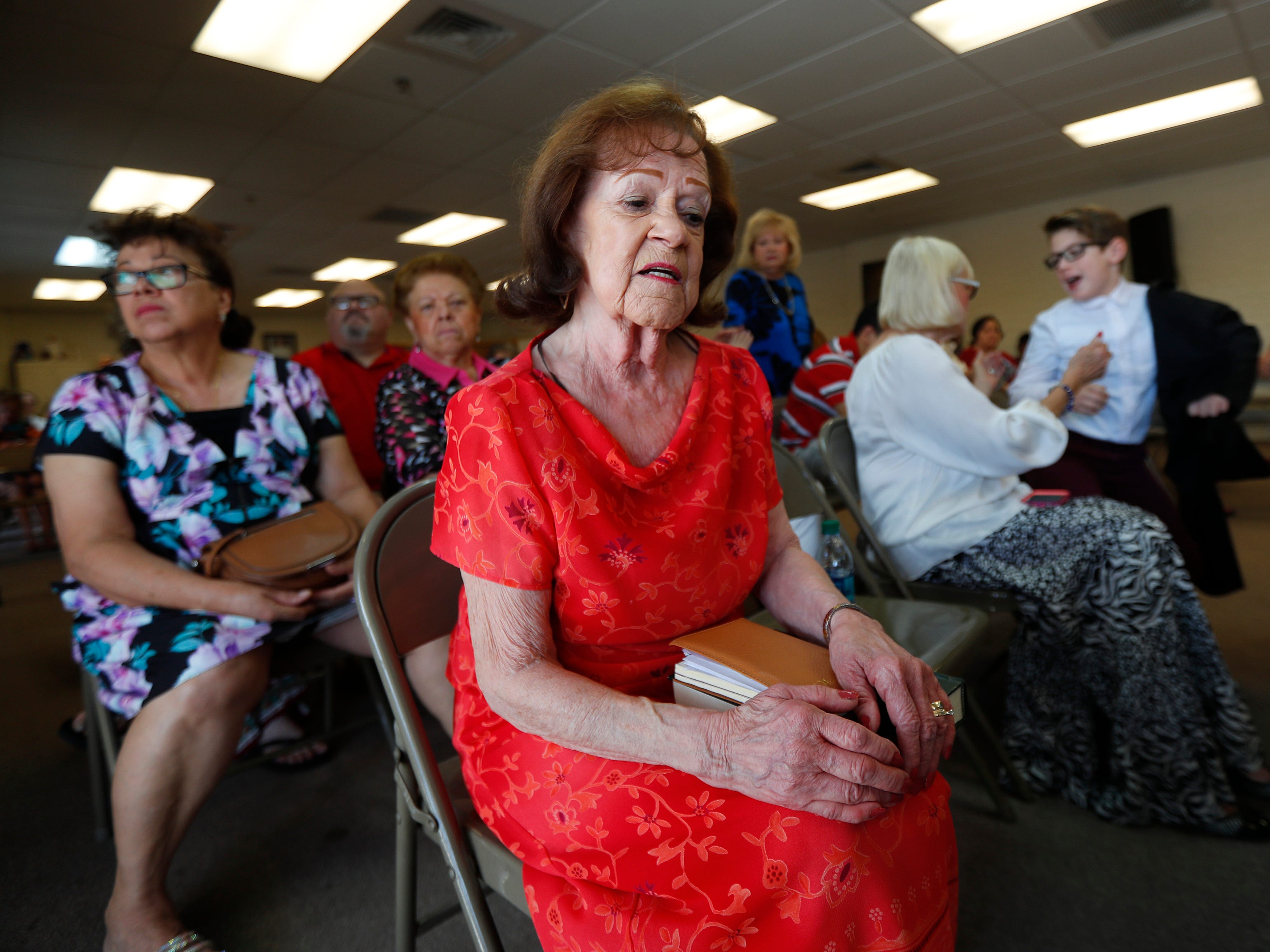 Pat Kjelstad, a congregant since the beginning, speaks about the damage after a fire to St. Joseph's Catholic Church in the Ascension Hall where Masses will now be held in Phoenix on May 5, 2019.