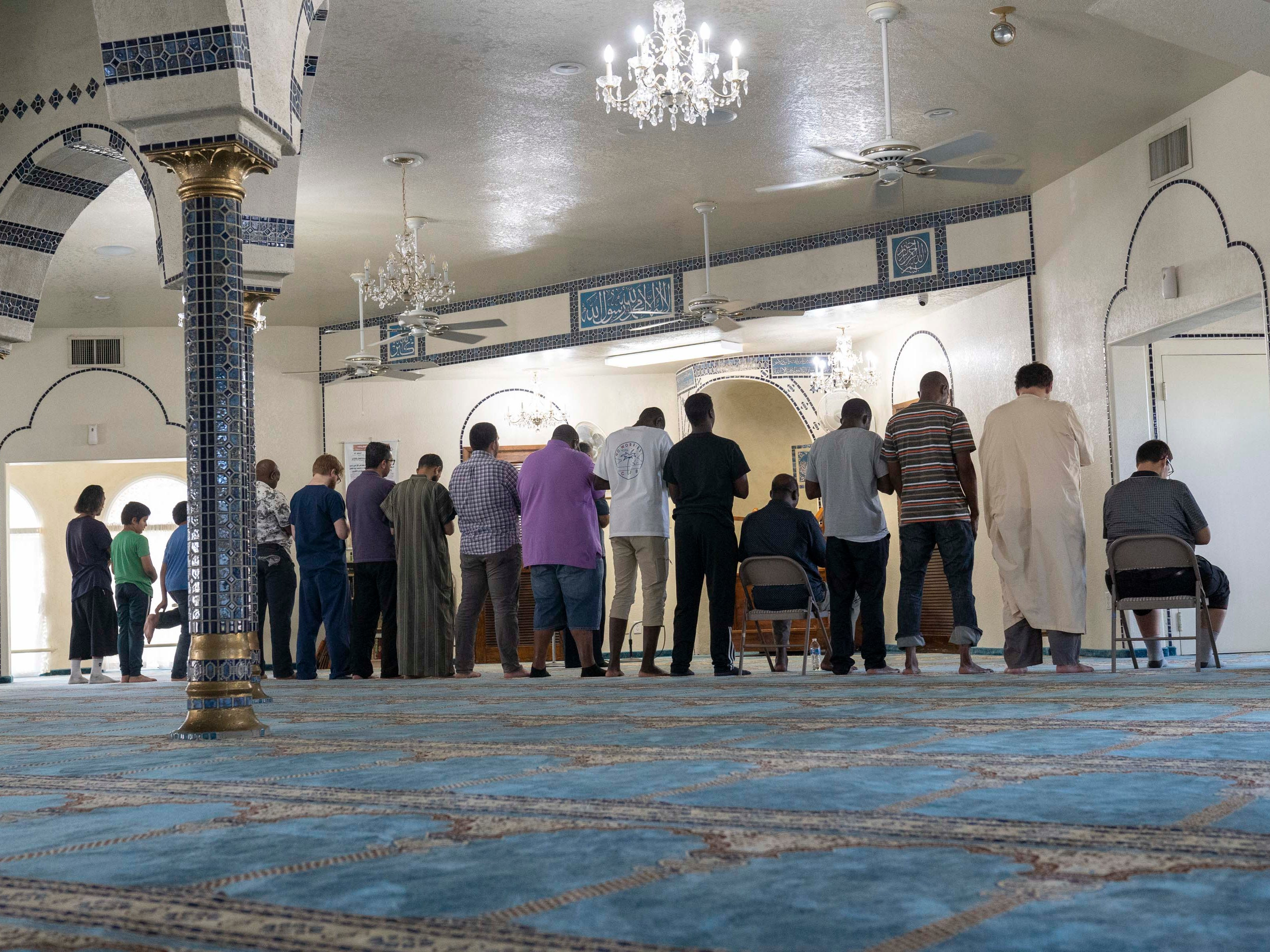 Muslim men pray during the evening prayer at Tempe Islamic Cultural Center.