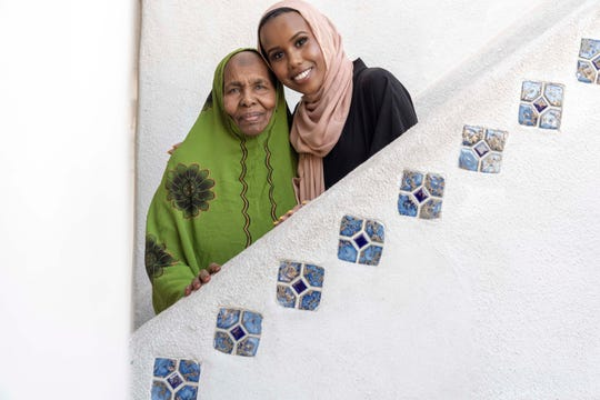 Somali Muslim Khadija Shire, 89, and her granddaughter Hawa Osman, pose for a portrait as they sell clothing to the Muslim community for Ramadan at Tempe Islamic Cultural Center.