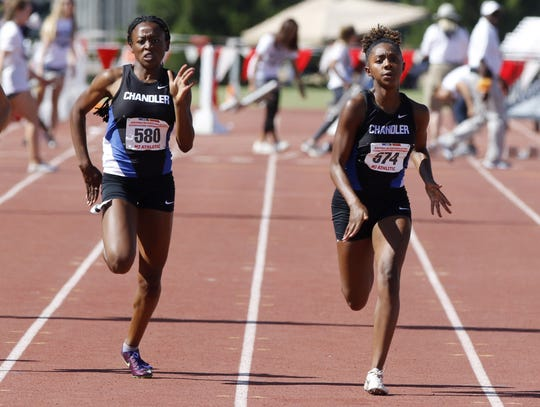 Chandler's Trinity Henderson (right) Jocelyn Johnson (left) finish first and second in the Division I 100 meters during the 2019 Arizona State Track and Field Championship at Mesa Community College in Mesa, Arizona, May 04, 2019.