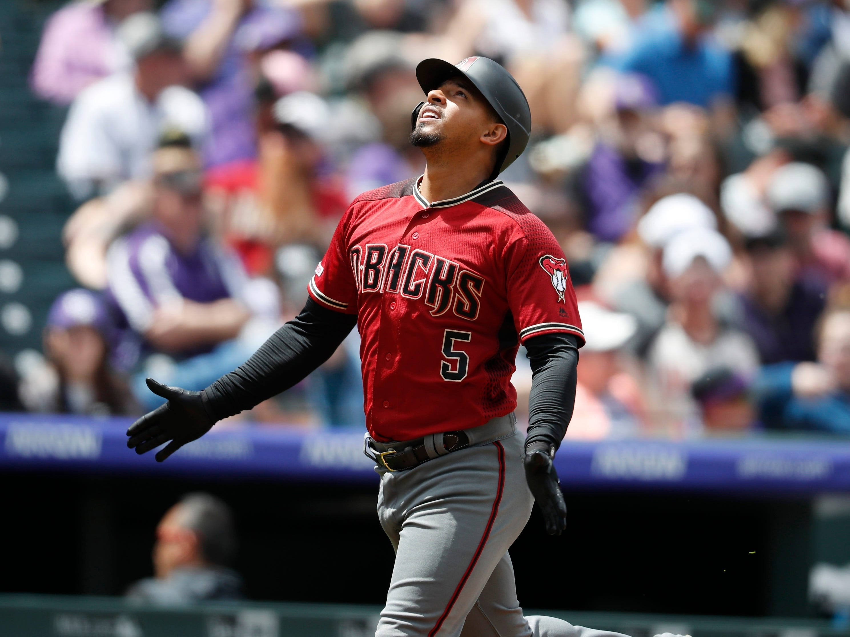 Arizona Diamondbacks' Eduardo Escobar gestures as he circles the bases after hitting a solo home run off Colorado Rockies starting pitcher German Marquez in the second inning of a baseball game Sunday, May 5, 2019, in Denver. (AP Photo/David Zalubowski)