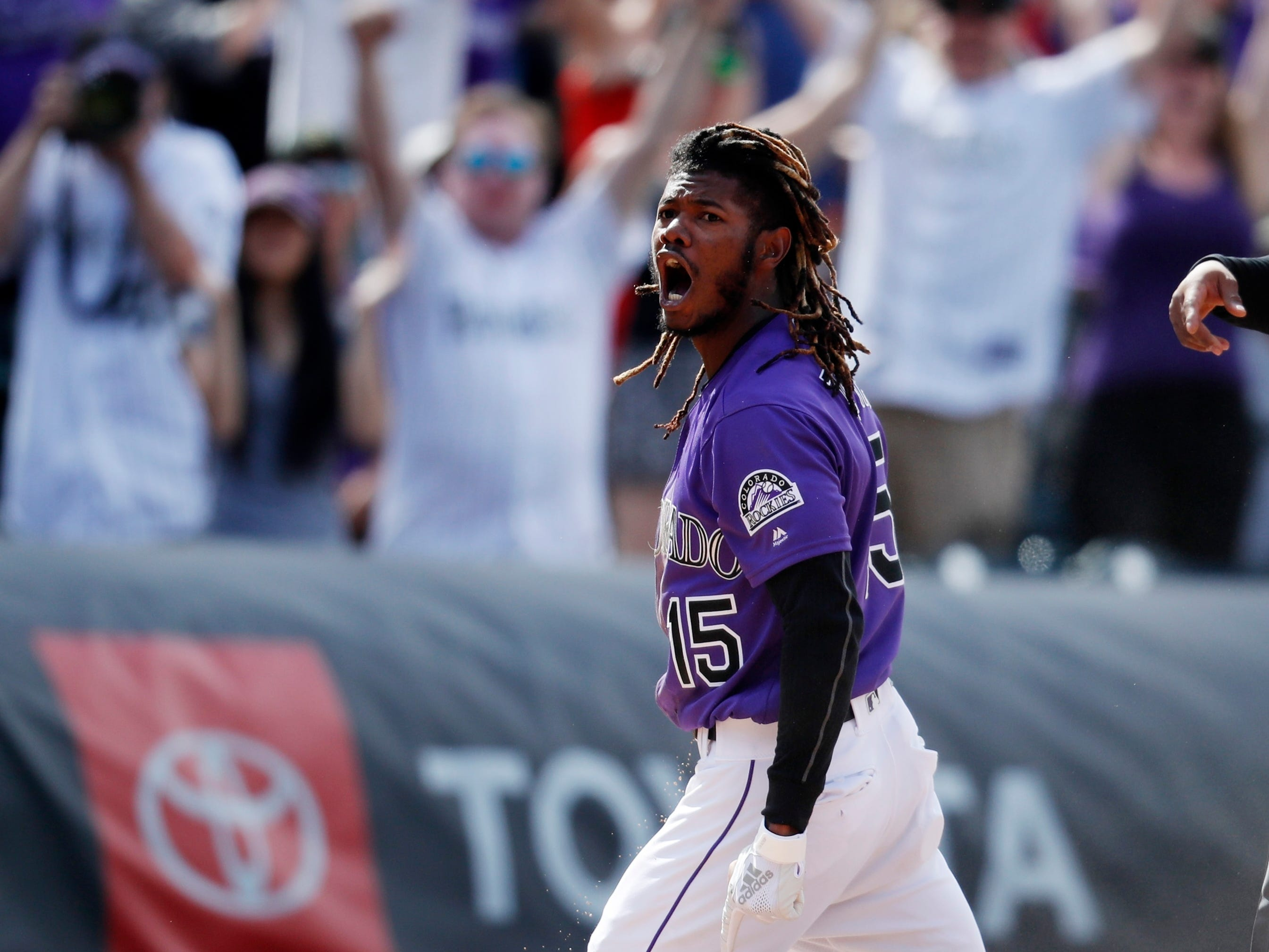 Colorado Rockies' Raimel Tapia rects after tripling to drive in three runs off Arizona Diamondbacks relief pitcher Archie Bradley in the eighth inning of a baseball game Sunday, May 5, 2019, in Denver. (AP Photo/David Zalubowski)