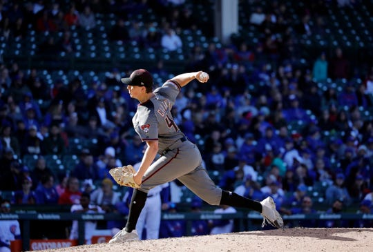 Arizona Diamondbacks relief pitcher Taylor Clarke throws against the Chicago Cubs during the ninth inning of a baseball game Saturday, April 20, 2019, in Chicago. The Diamondbacks won 6-0.