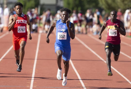 Tucson's Octavius Thomas, Chandler's Quaron Adams, and Mountain Pointe's Jathan Washington, compete in the Boys 100 Meter dash Div. I during the state track and field meet at Mesa Community college on May 1, 2019.