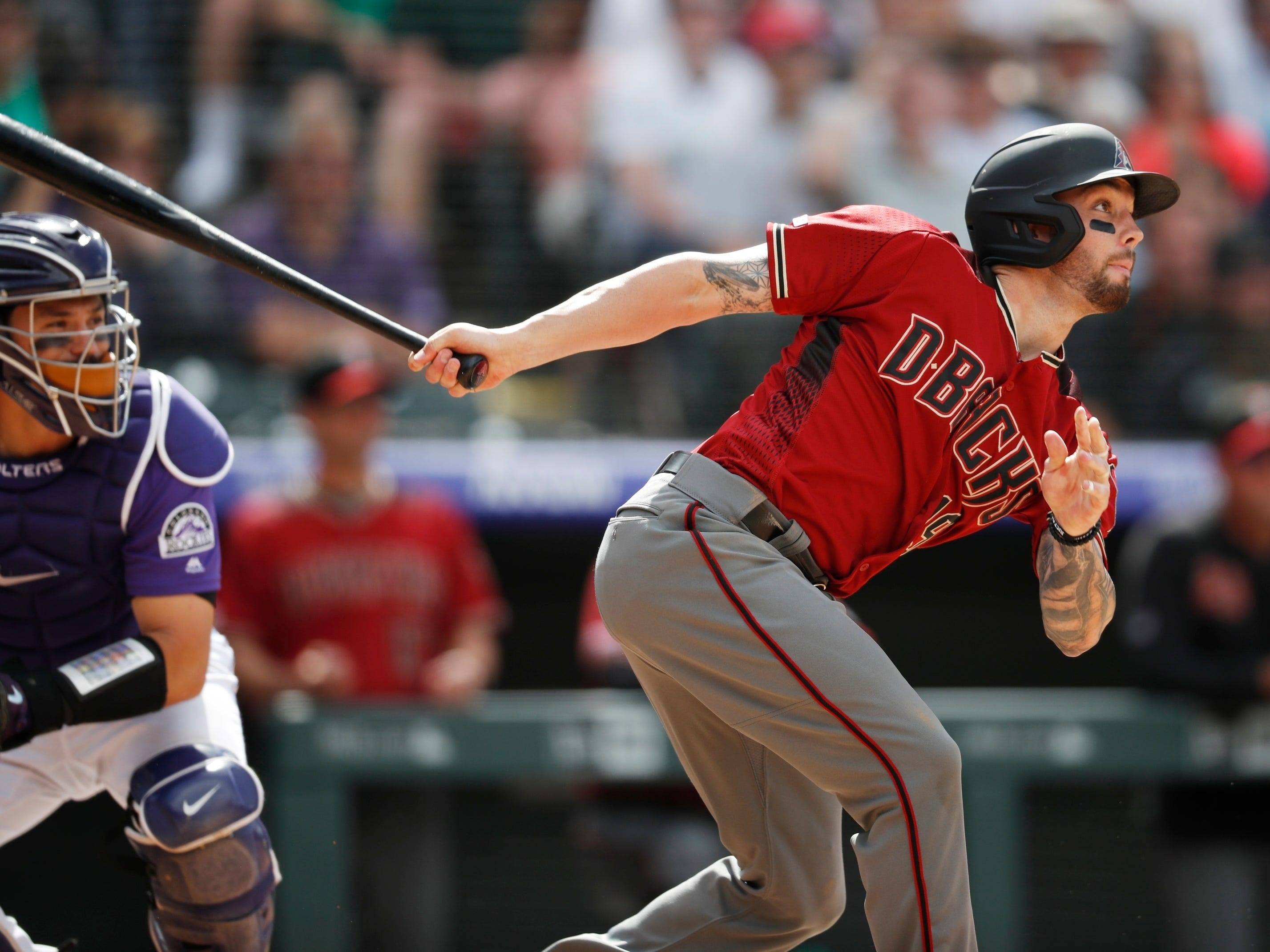 Arizona Diamondbacks' Blake Swihart follows the flight of his single off Colorado Rockies relief pitcher Scott Oberg in the eighth inning of a baseball game Sunday, May 5, 2019, in Denver. (AP Photo/David Zalubowski)