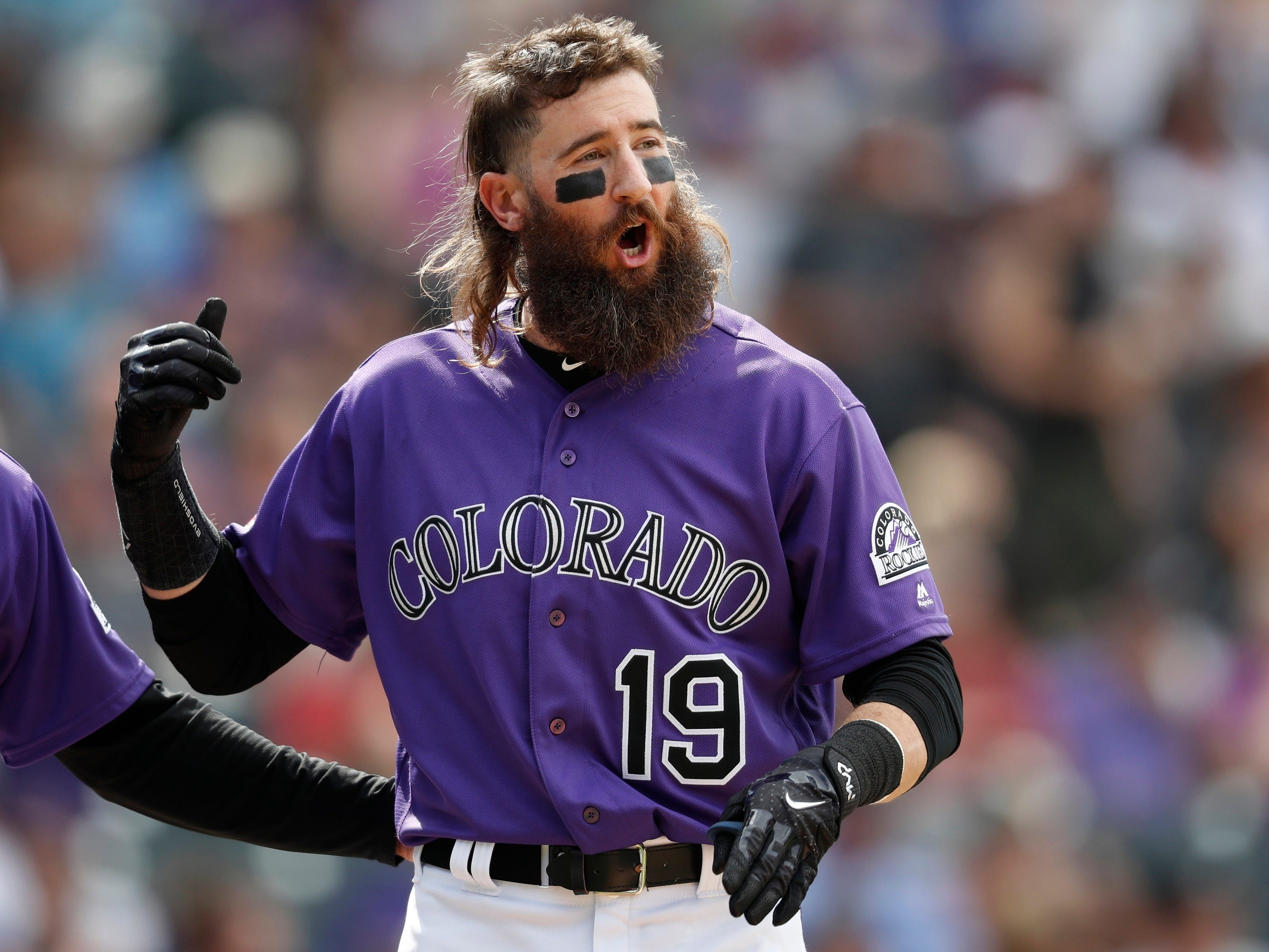 Colorado Rockies center fielder Charlie Blackmon argues with first base umpire Scott Barry after he ruled that Blackmon's ground ball was fair--not foul--and was counted as the final out in the seventh inning of a baseball game against the Arizona Diamondbacks Sunday, May 5, 2019, in Denver. (AP Photo/David Zalubowski)