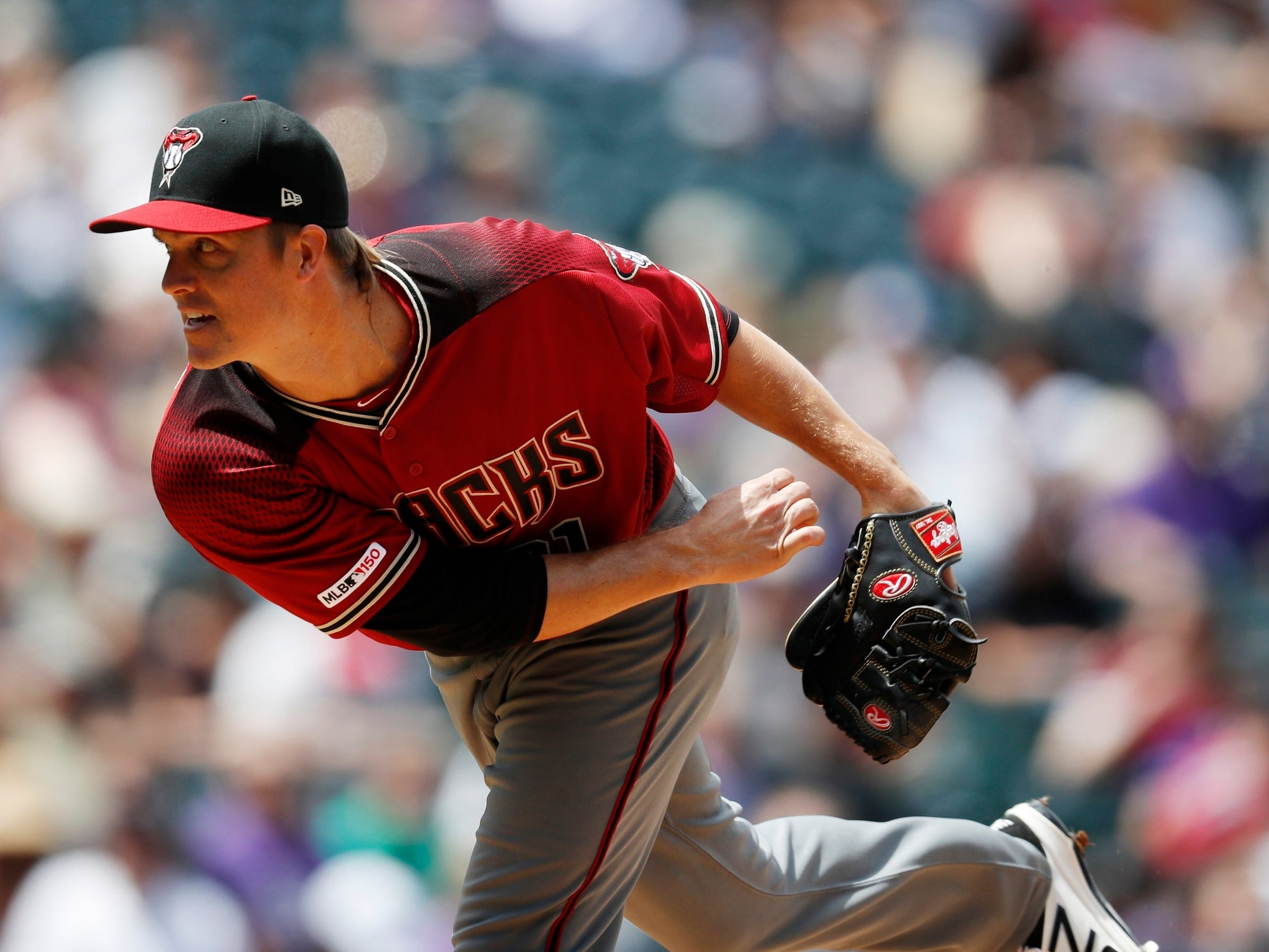 Arizona Diamondbacks starting pitcher Zack Greinke works against the Colorado Rockies in the first inning of a baseball game Sunday, May 5, 2019, in Denver. (AP Photo/David Zalubowski)