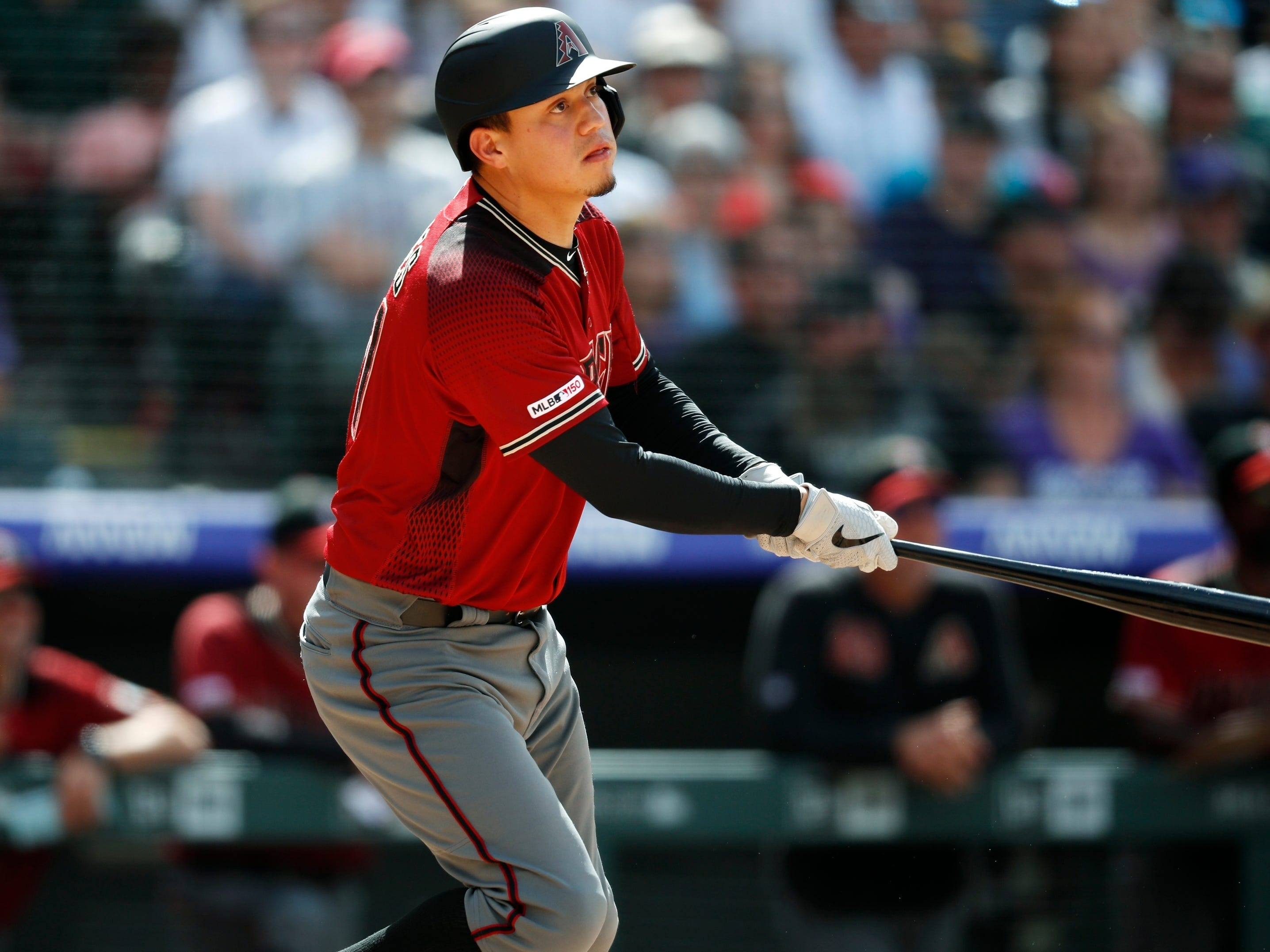 Arizona Diamondbacks pinch-hitter Wilmer Flores follows the flight of his RBI-single off Colorado Rockies relief pitcher Scott Oberg in the eighth inning of a baseball game Sunday, May 5, 2019, in Denver. The Rockies won 8-7. (AP Photo/David Zalubowski)