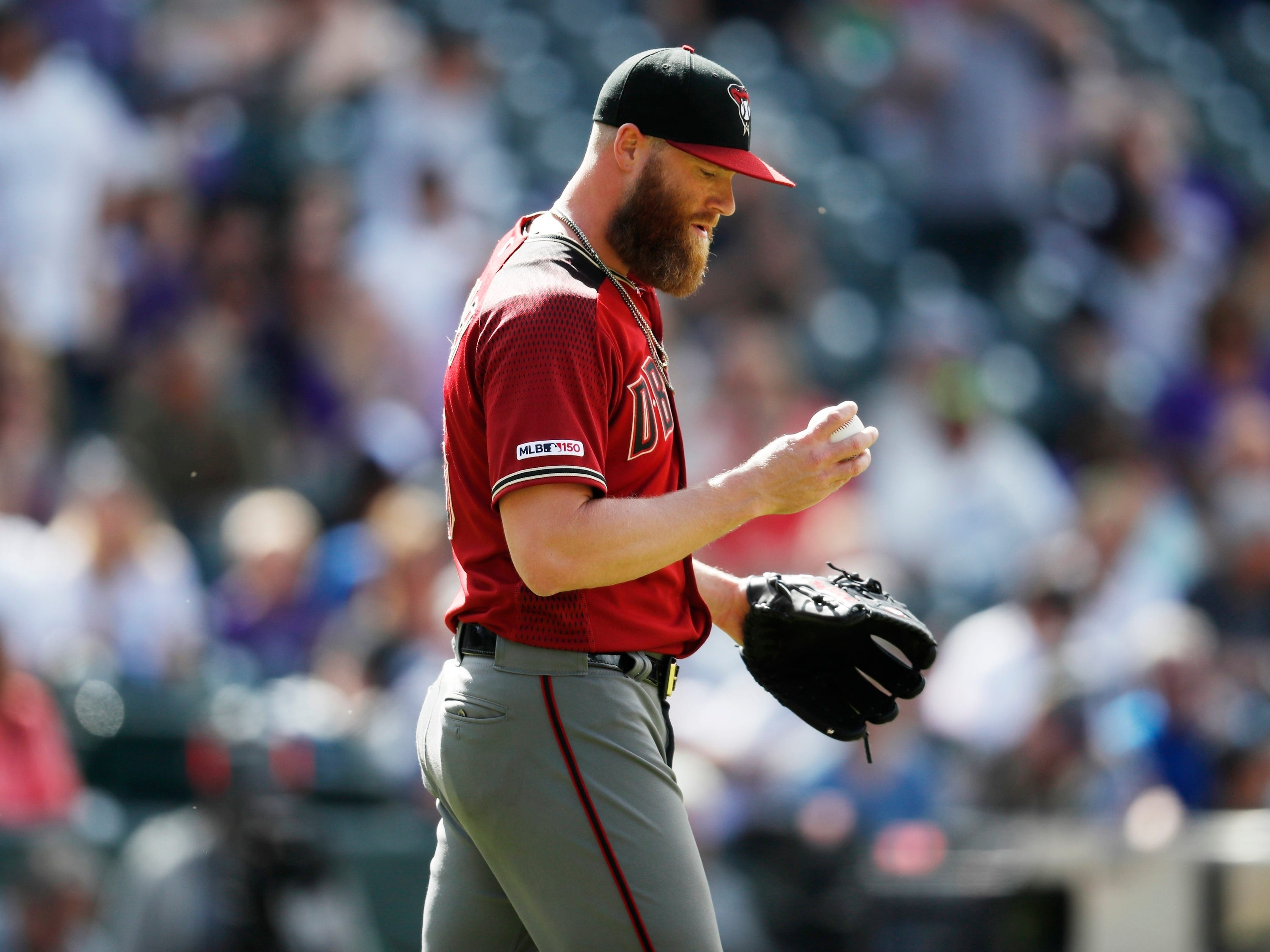 Arizona Diamondbacks relief pitcher Archie Bradley reacts after giving up a single to Colorado Rockies' Nolan Arenado in the eighth inning of a baseball game Sunday, May 5, 2019, in Denver. The Rockies won 8-7. (AP Photo/David Zalubowski)