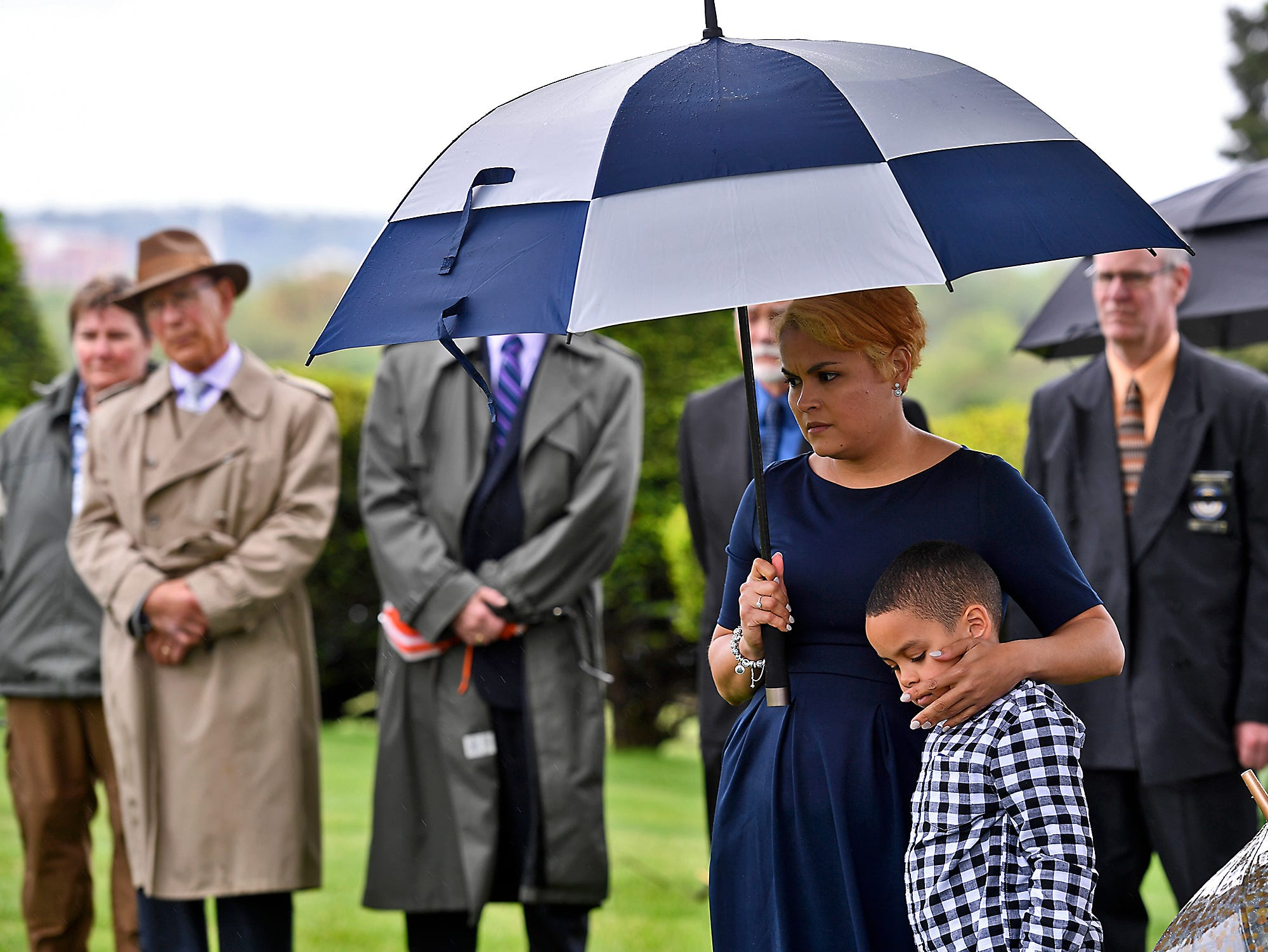 Rebeca Sable and her son Ethan attend a grave side service for her husband Officer Alex Sable during the Fraternal Order of Police (FOP) Lodge 15 annual memorial service, Sunday, May 5, 2019, at Prospect Hill Cemetery.John A. Pavoncello photo