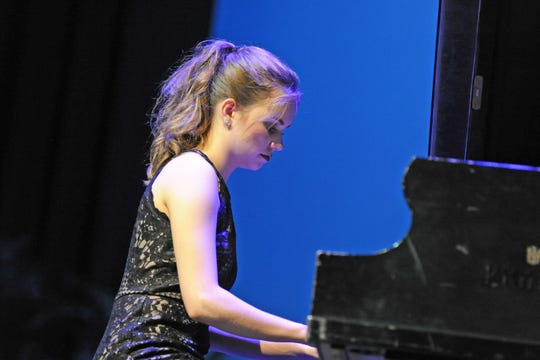 Ivy Snyder, a student at Spring Grove Area High School, performs on the piano for the 2019 Distinguished Young Women of York County competition. Snyder won first place.