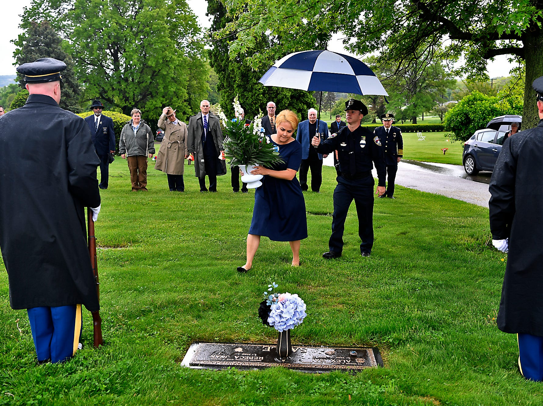 Rebeca Sable places flowers on the grave site of her husband Officer Alex Sable the Fraternal Order of Police (FOP) Lodge 15 honor their fallen during the annual memorial service, Sunday, May 5, 2019, at Prospect Hill Cemetery.John A. Pavoncello photo