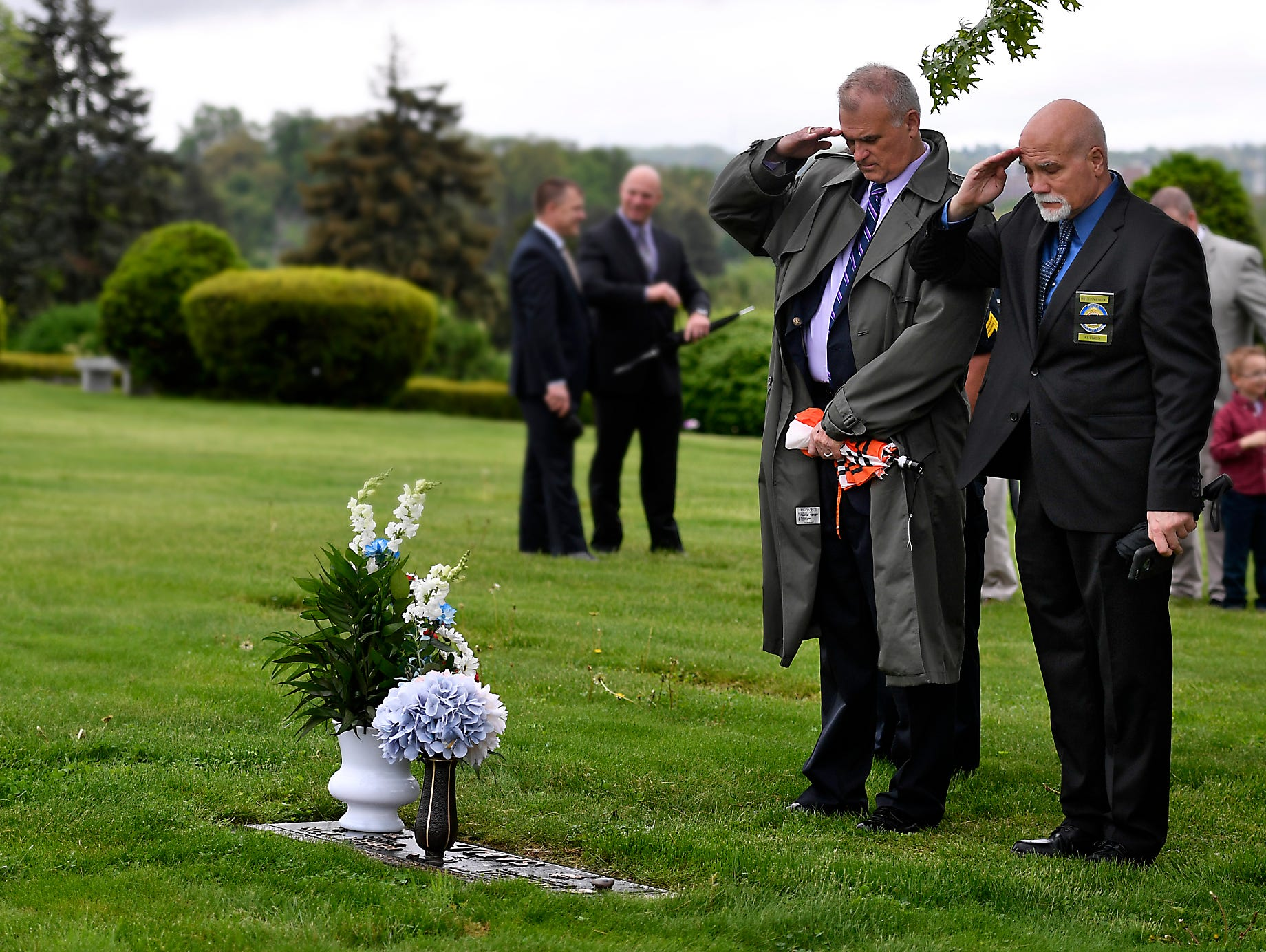 Spring Garden Township Police Chief George Swartz, left, and retired York City police officer Bruce Veseth salute the grave of Officer Alex Sable at Prospect Hill Cemetery, Sunday, May 5, 2019 during the FOP Lodge 15 memorial service.John A. Pavoncello photo