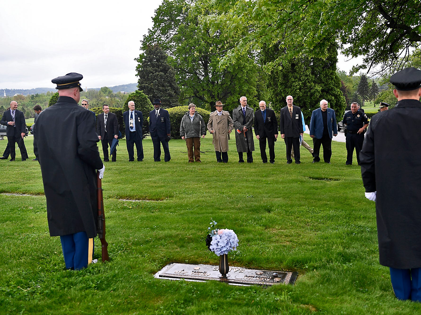 Honor Guard members stand beside the grave site of Officer Alex Sable as the Fraternal Order of Police (FOP) Lodge 15 hold their annual memorial service, Sunday, May 5, 2019, at Prospect Hill Cemetery.John A. Pavoncello photo