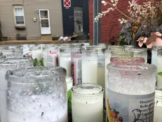 Candles at the scene of York's most recent homicide investigation in the 200 block of South Pershing Avenue.