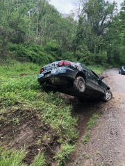 Mushroom car ends up in ditch after driver pulls e-brake on Gut Road in East Manchester Township.