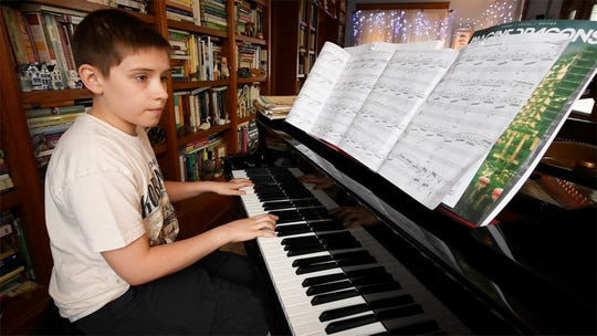 Tyler Spangler concentrates on a piano piece at his home in Windsor Township. He takes piano and drum lessons, playing a number of percussion instruments for the York Junior Symphony.