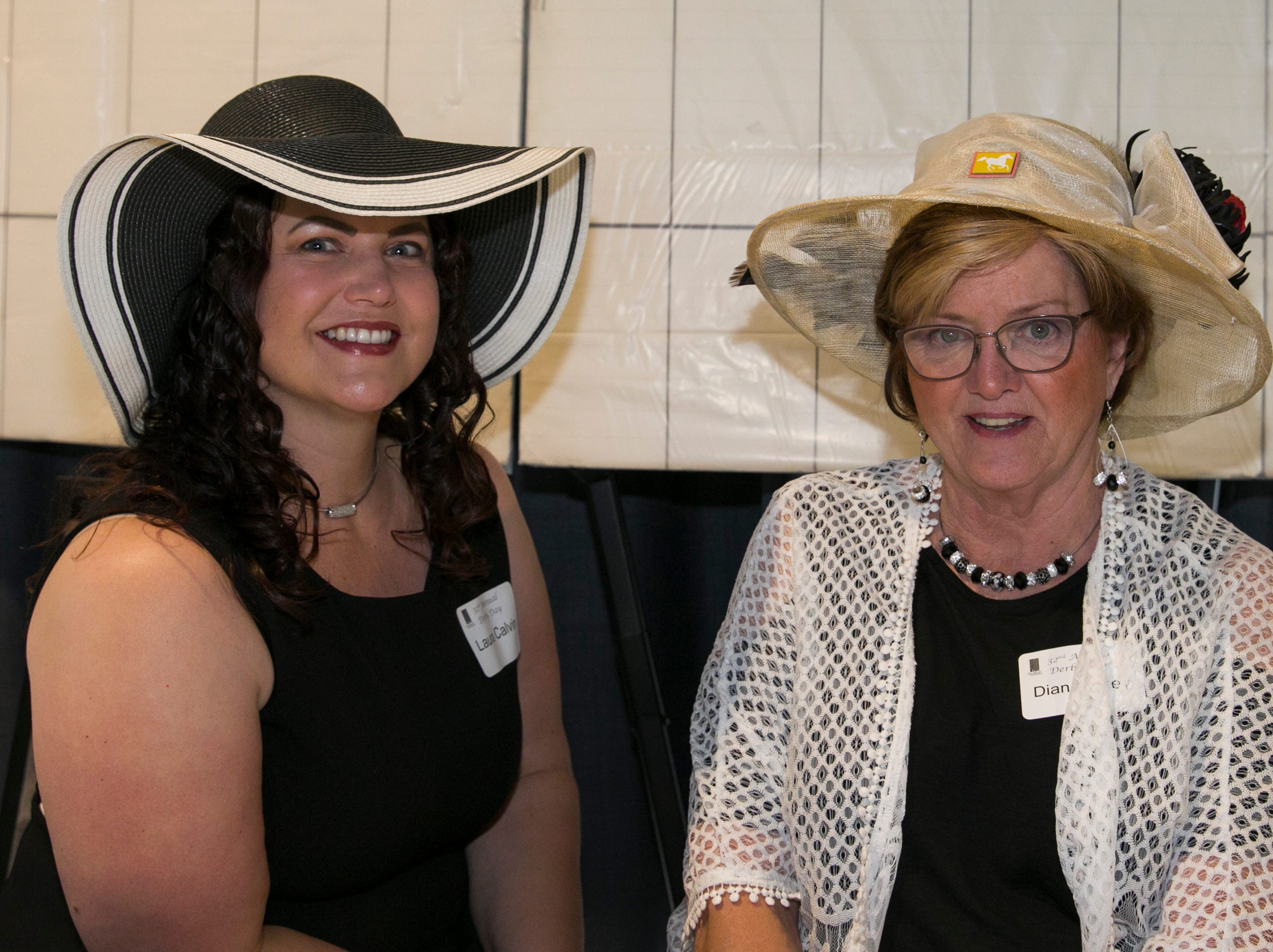 Laura Calvin and Diana Foley during the Derby Day fundraiser for the Reno Chamber Orchestra at the Renaissance Reno on Saturday, May 4, 2019.