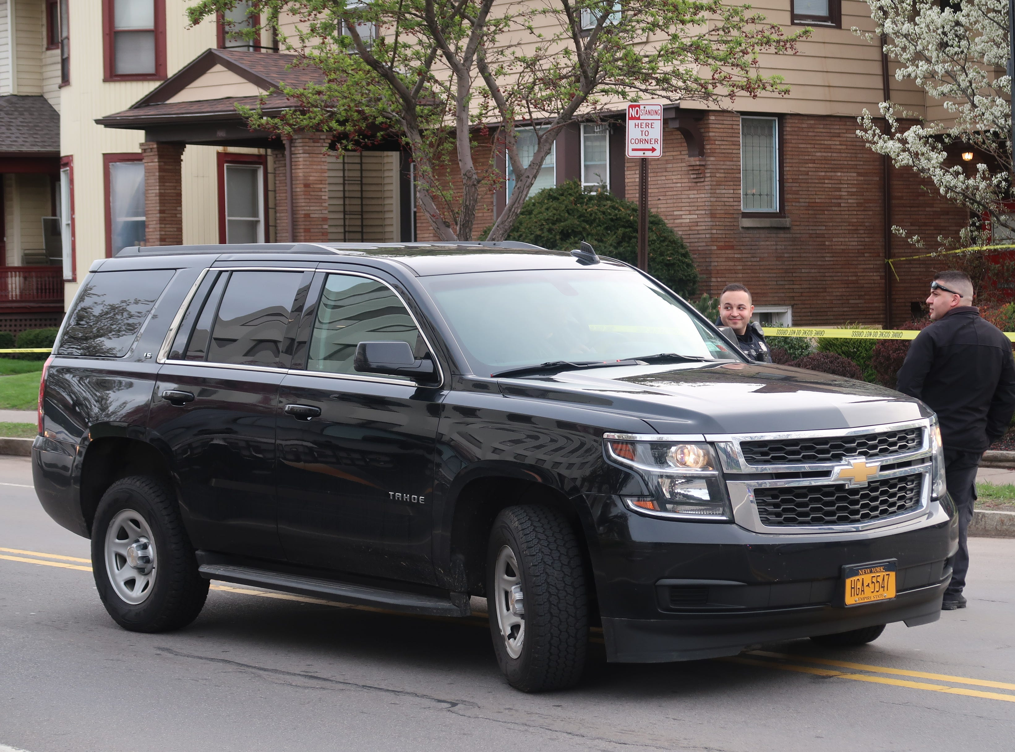 Police investigate after a man was found dead inside a vehicle at 223 Alexander St. on May 4, 2019.