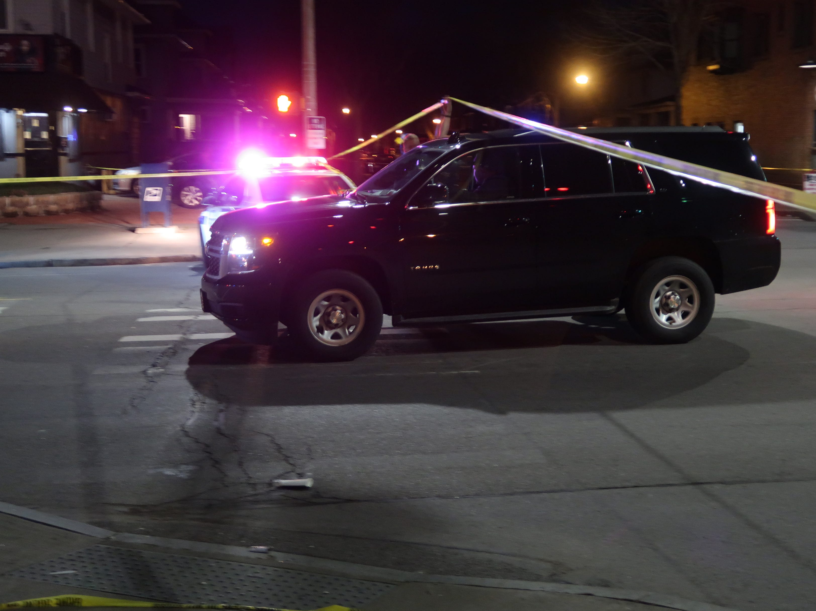 First Assistant District Attorney Perry Duckles arrives at a homicide scene late Saturday night in Rochester's Maplewood neighborhood.