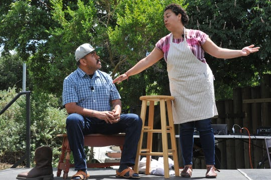 "Actors Mauricio Samano and Karina Salcedo perform a scene from the Baktun 12 play ""La Cortina de la Lechuga"" at the Take It Outside Salinas event on May 5, 2019."