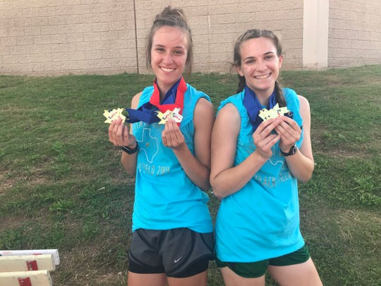 Cornerstone Christian School's Hannah Slate, left, and Jessica Simon display their six gold medals and one silver from the 2019 TAPPS Class 1A State Track and Field Championships Saturday, May 4, 2019, in Waco.