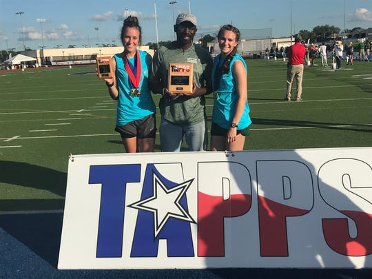 Cornerstone Christian School's Hannah Slate, left to right, head coach Gary Gabriel and Jessica Simon hold their hardware from the TAPPS Class 1A State Track and Field Championships Saturday in Waco. The large plaque is actually for a third-place team finish but the team of two actually finished tied for second and will be awarded another plaque.
