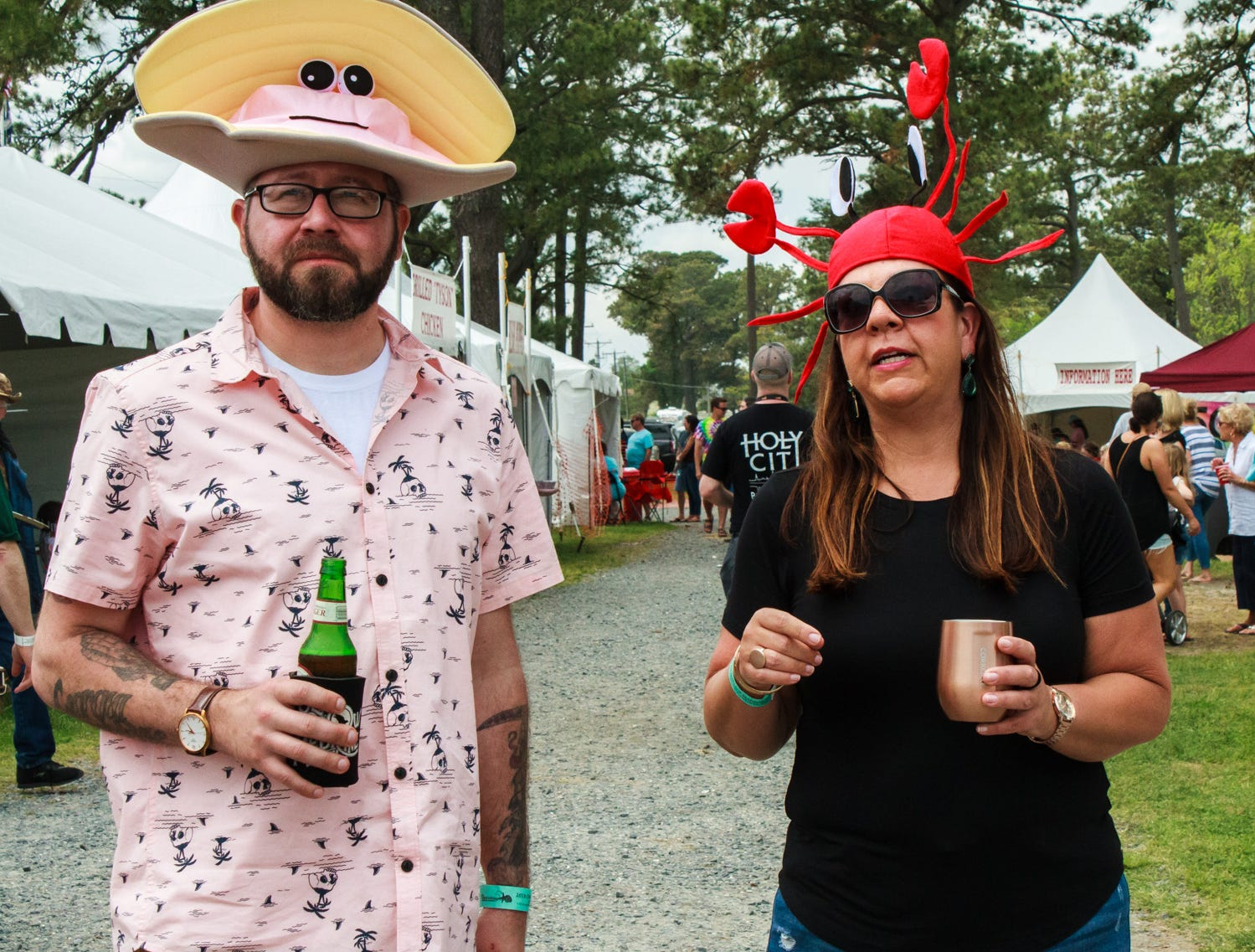 Chastity Moran and Stephen Lewis of Wilmington, DE stare down long lines ahead of them on Saturday, May 4, 2019 at the Chincoteague Seafood Festival in Chincoteague, VA.