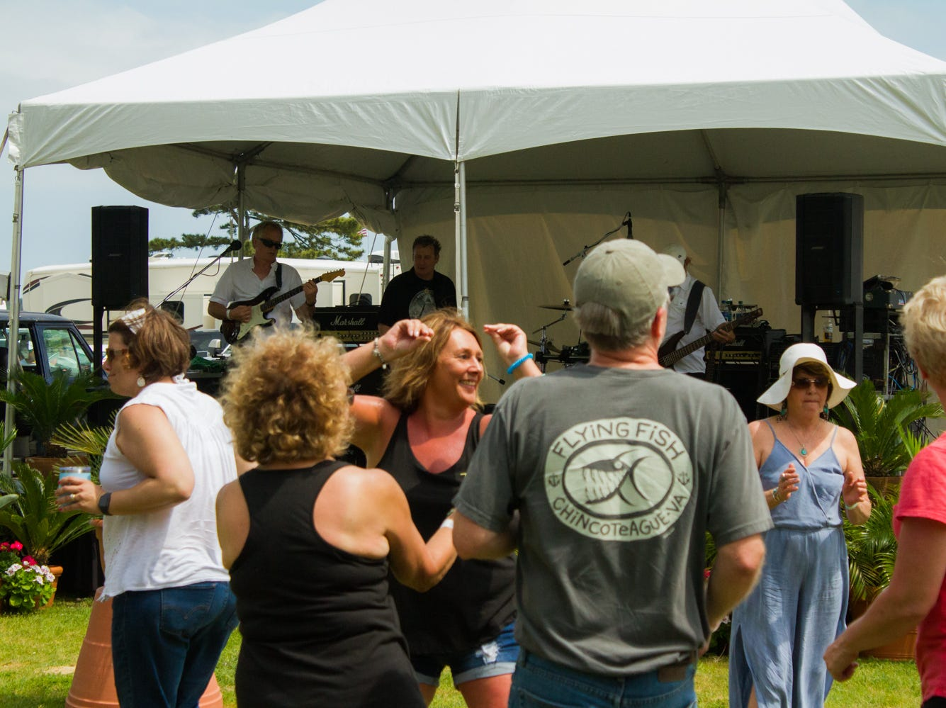 Festival attendees dance to the sounds of Front Page News on Saturday, May 4, 2019 at the Chincoteague Seafood Festival in Chincoteague, VA.