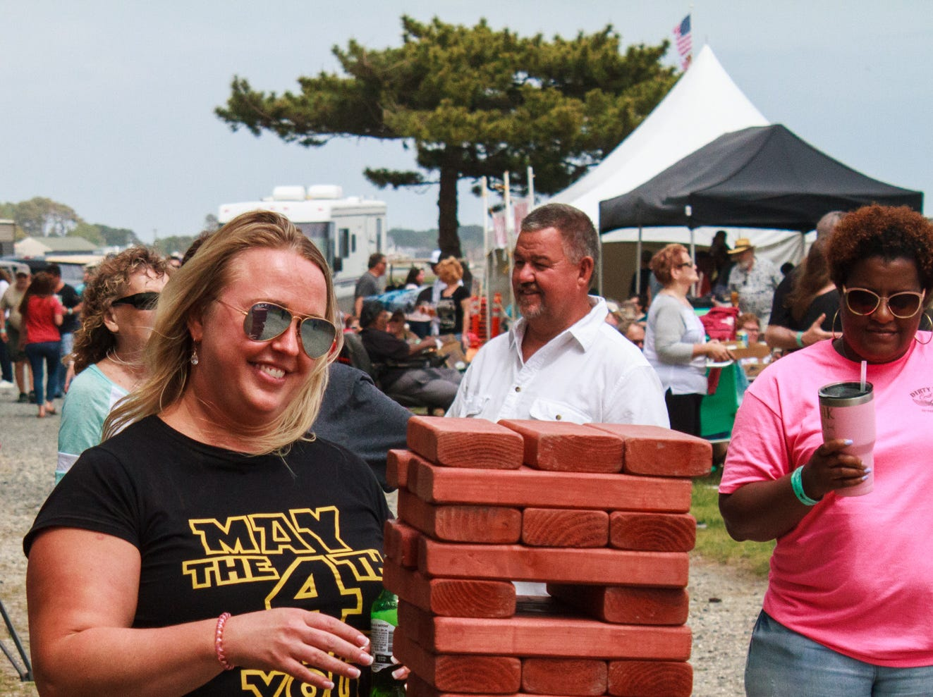 Tate Olson of Raleigh, NC plays a larger-than-usual version of Jenga on Saturday, May 4, 2019 at the Chincoteague Seafood Festival in Chincoteague, VA.